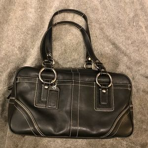 Black leather COACH bag with silver hardware.